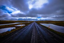 Free Road Through Flooded Landscape Stock Photography - 95997192