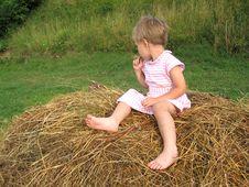 Free Girl On Hayrack Royalty Free Stock Photography - 963787