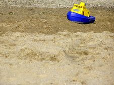 Toy Boat On The Beach Stock Photography