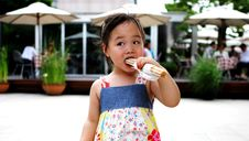 Free Young Asian Girl Having A Snack Stock Photos - 966743