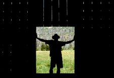 Silhouette Of Man, Old Barn, California Stock Images
