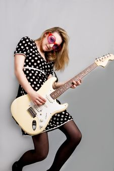 Free Young Girl Playing Guitar Stock Photos - 9603093
