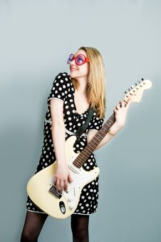 Free Smiling Blonde Playing Guitar Royalty Free Stock Photography - 9603147