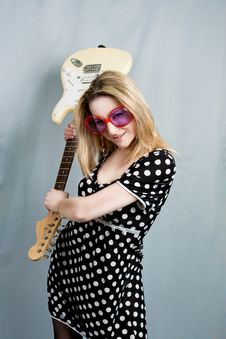 Blonde With Guitar Smiling Royalty Free Stock Photos