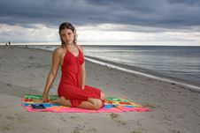 Free Girl With Red Dress On A Towel Stock Image - 9607001