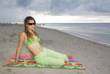 Pretty Girl With Sunglasses And Green Slacks Royalty Free Stock Photos