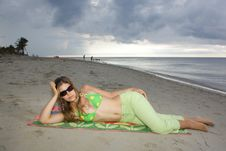 Lady Relaxing In The Beach, Laying On A Towel Royalty Free Stock Photography