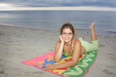Free Beautiful Lady Smiling, Laying On A Towel (I) Royalty Free Stock Photo - 9608015