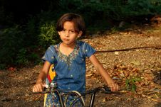 Free Girl Driving Her Bicycle Royalty Free Stock Photography - 9608827