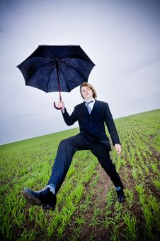 Free Businessman With Umbrella Royalty Free Stock Photography - 9609567