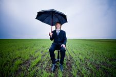Free Businessman With Umbrella Royalty Free Stock Photography - 9609587