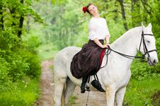 Free Cheerful Girl Riding Horse Stock Photos - 9609773