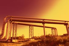 Free Industrial Pipelines Against Blue Sky. Royalty Free Stock Photography - 9609977