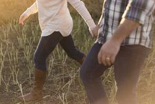Free Man In White Blue And Black Plaid Dress Shirt Blue Jeans Holding Hand With Girl In White Sweater Blue Jeans And Brown Leather Boot Royalty Free Stock Images - 96055179