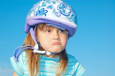 Free Grimacing Girl With A Helmet Royalty Free Stock Images - 9611109