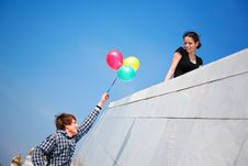 Free Young Girl And Boy Against Blue Sky Royalty Free Stock Photo - 9612495