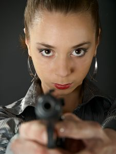 The Beautiful Girl With A Pistol Royalty Free Stock Images