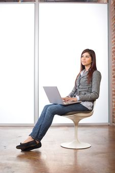 Woman Relaxing With Laptop Royalty Free Stock Image