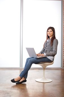 Smiling Woman With Laptop Stock Photo