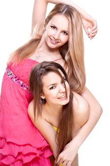 Two Beautiful Women In A Colored Dress Royalty Free Stock Photos