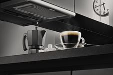 Free Clear Glass Coffee Cup With Black Coffee On Black Kitchen Top Beside Black Coffee Maker Royalty Free Stock Photo - 96113705