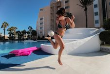 Free Woman Beside Pool Kicking Football Stock Photos - 96113853