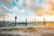 Free Man Standing In Wood In The Middle Of The Ocean While Fishing Under Blue And White Sky During Day Time Stock Image - 96116231