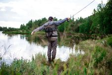 Free Man In Brown Pants Casting Fishing Rod Into Lake Stock Photos - 96117013