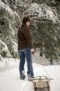 Free Beautiful Woman Pulling Sled Through Snow Stock Photo - 9628270