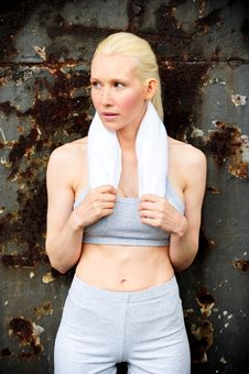 Free Blond Female Jogger Leaning Against A Wall Royalty Free Stock Photography - 9620107