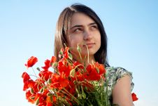 Free Girl On A Red Poppies Field Royalty Free Stock Image - 9620666