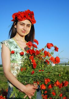 Free Girl On A Red Poppies Field Stock Photo - 9620890
