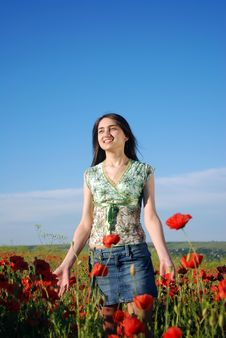 Free Girl On A Red Poppies Field Royalty Free Stock Photography - 9621077