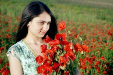 Free Girl On A Red Poppies Field Royalty Free Stock Image - 9621256