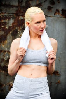 Free Blond Female Jogger Leaning Against A Wall Stock Photo - 9622230