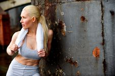 Free Blond Female Jogger Leaning Against A Wall Stock Photo - 9622770
