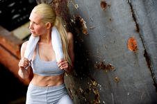 Free Blond Female Jogger Leaning Against A Wall Royalty Free Stock Photography - 9622827