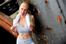 Free Blond Female Jogger Leaning Against A Wall Royalty Free Stock Photo - 9622855
