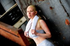 Free Blond Female Jogger Leaning Against A Wall Stock Image - 9622881