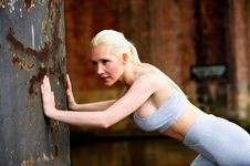 Free Fit Athletic Woman Stretching Against A Wall Royalty Free Stock Image - 9622976