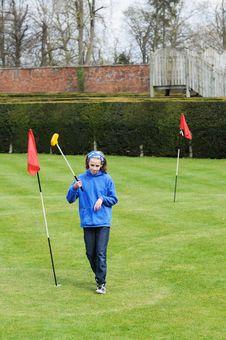 Girl Playing Mini Golf Stock Photo