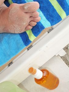 Sandy Toes On A Beach Towel Stock Images
