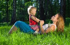 Free Young Mother Playing With  Daughter Stock Image - 9627561