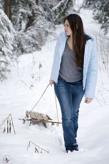 Free Beautiful Woman Pulling Sled Royalty Free Stock Photos - 9628428