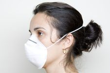 Free Young Woman Putting On A Mask Against Swine Flu Stock Photography - 9630712