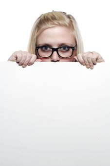 Free Young Blonde Girl Hiding Behind White Board Royalty Free Stock Images - 9631319
