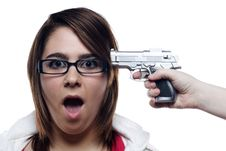 Young Woman With Gun To Head Royalty Free Stock Photos