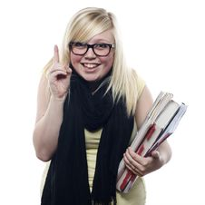 Young Blonde Student Holding Books Stock Photo