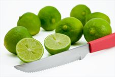 Free Limes Being Cut By Red Knife Stock Photography - 9632292