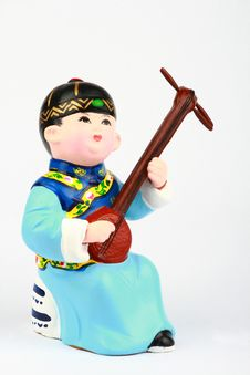 Free Clay Figure Of Asian Boy Playing Music Royalty Free Stock Photography - 9634777